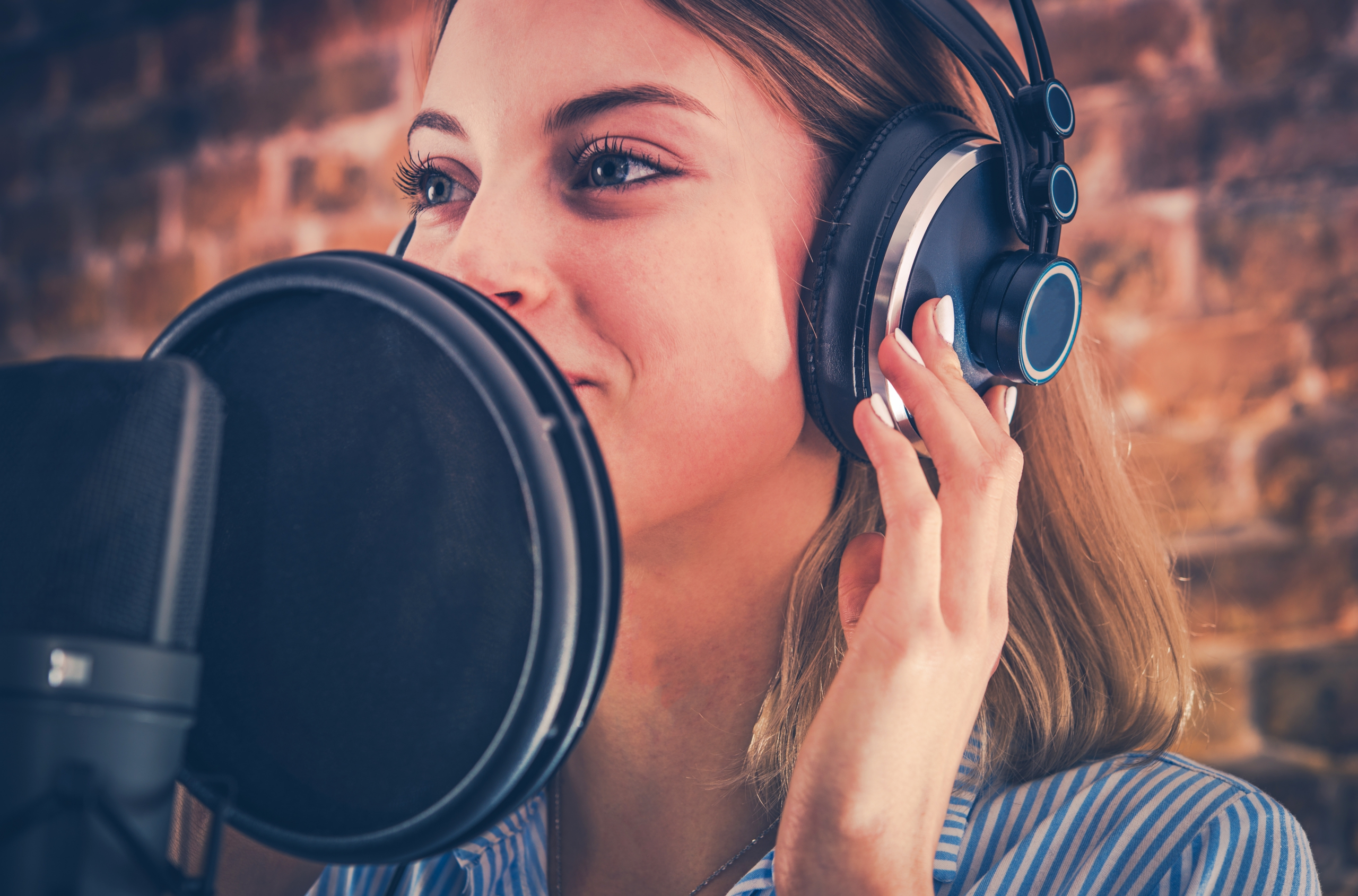 woman recording audiobook P8HH37P scaled